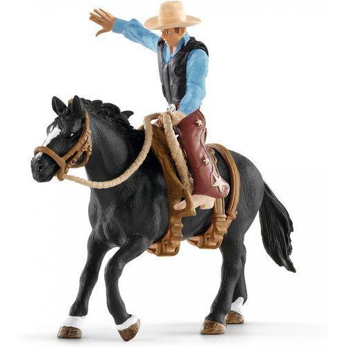 Kowboj siodłający dzikiego konia - Schleich (4005086414167)