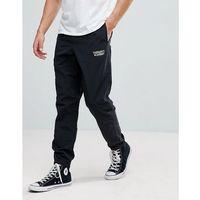 academy track pants - black marki Carhartt wip