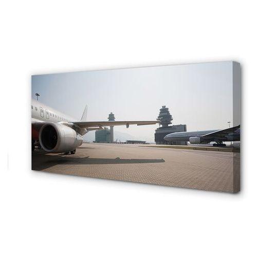 Tulup.pl Obrazy na płótnie samolot budynki lotnisko niebo