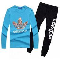 Dresy bluza niebieska (czerwone/białe logo), spodnie czarne/białe pf13512, Adidas