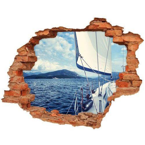Dziura 3d w ścianie naklejka jacht na tle morza marki Wallmuralia.pl