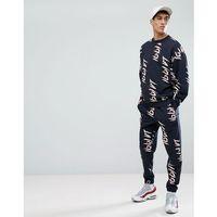 Asos tracksuit oversized sweatshirt/slim joggers with graffiti print in navy - navy