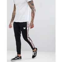 skinny joggers in black with logo side stripes - navy marki Good for nothing