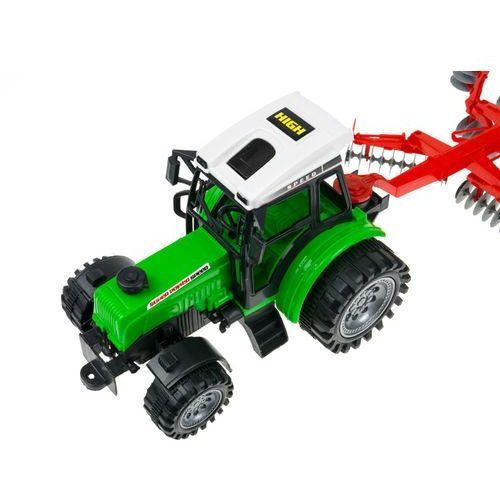 Traktor z ruchomą maszyną broną talerzową 666-54A