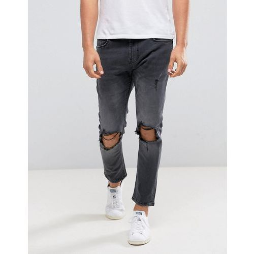Bershka Skinny Tapered Jeans With Knee Rip In Washed Black - Black, kolor czarny