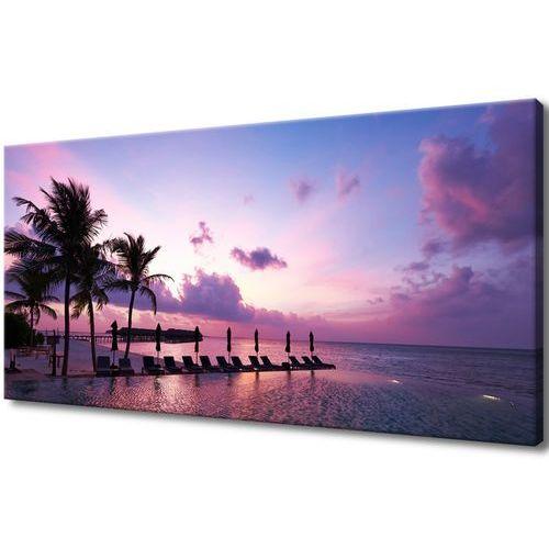 Obraz na Płótnie Zachód słońca na plaży na Malediw