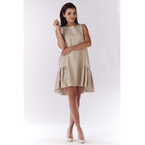 Beżowa sukienka wizytowa z falbanką na dole marki Awama