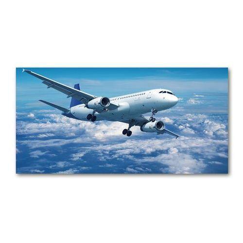 Foto obraz szklany Samolot w chmurach