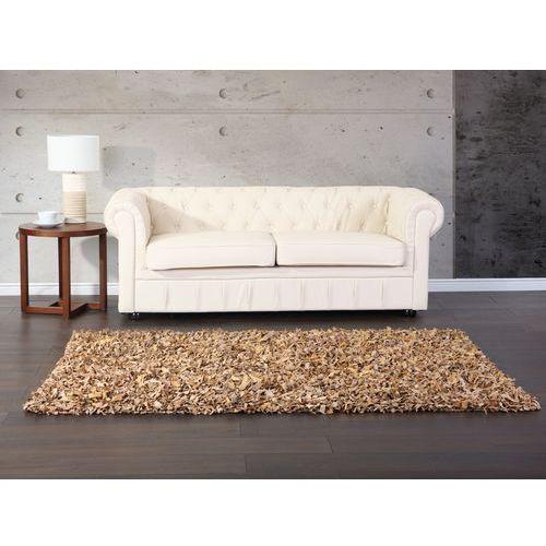 Dywan beżowy - 80x150 cm - shaggy -skórzany - mut od producenta Beliani
