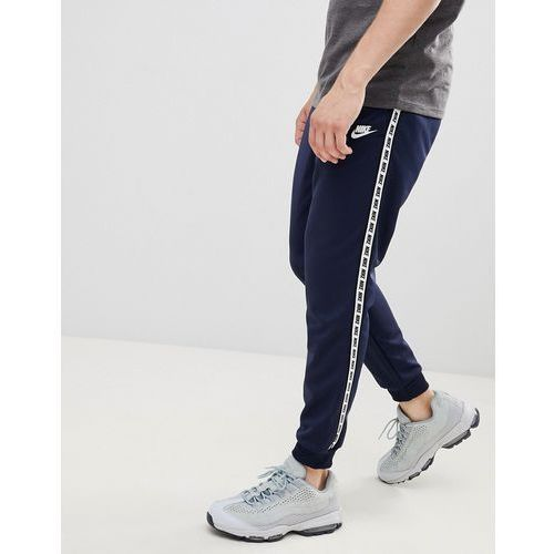 Nike taping skinny fit joggers in navy ar4912-451 - navy