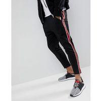 skinny track joggers with side stripes in black - black marki Mennace