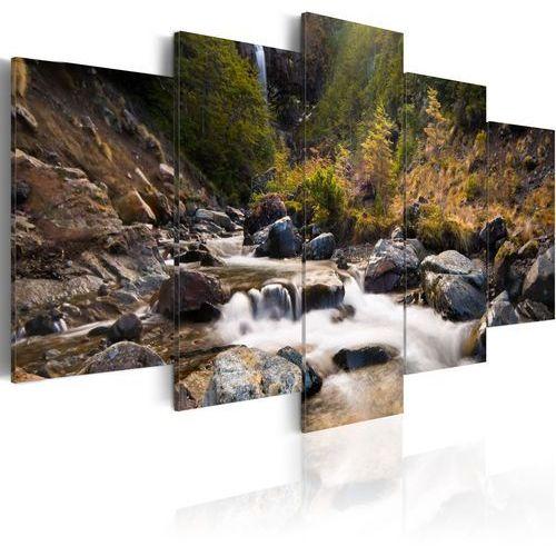 Obraz - wodospad pośrodku dzikiej natury marki Artgeist