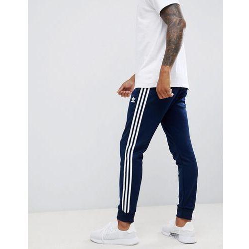 adidas Originals 3-stripe skinny joggers with cuffed hem in navy DH5834 - Navy, w 2 rozmiarach