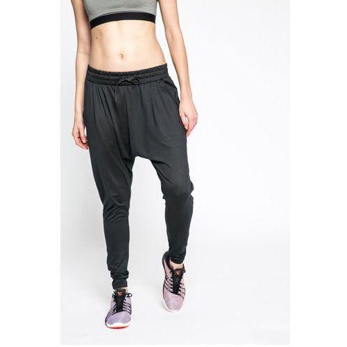 Nike - spodnie w nk flow lx pant
