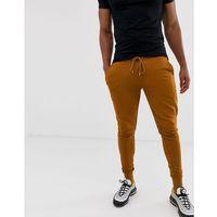 ASOS DESIGN skinny joggers in dark orange - Orange, 1 rozmiar