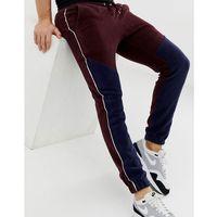 skinny joggers in fleece colourblock - red marki Asos design