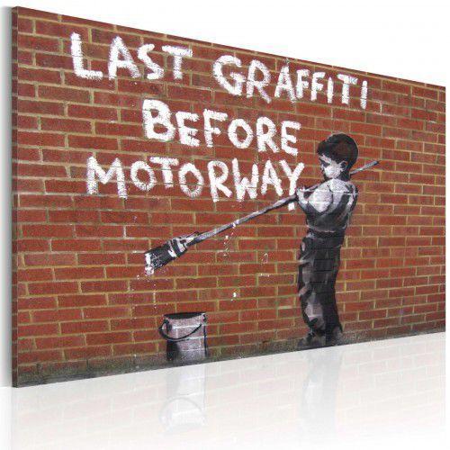 Artgeist Obraz - ostatnie graffiti przed autostradą (banksy)