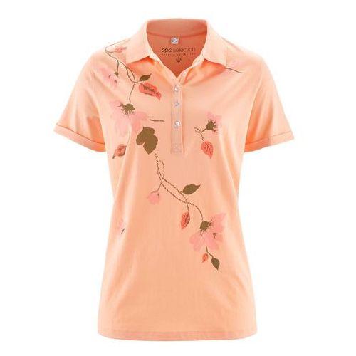 Shirt polo bonprix brzoskwiniowo-łososiowy z nadrukiem, kolor pomarańczowy
