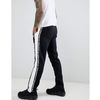 ASOS DESIGN slim joggers with taping & poppers - Black, w 4 rozmiarach