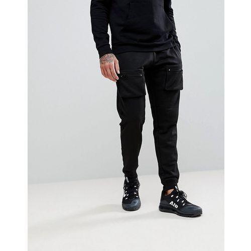 Boohooman skinny joggers with zip pocket detail in black - black