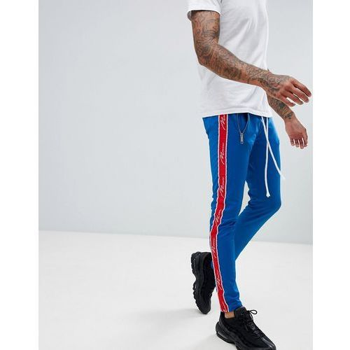 boohooMAN skinny fit tracksuit bottoms with taping in blue - Blue, w 4 rozmiarach
