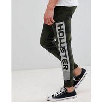 Hollister print logo camo print skinny joggers in olive green - green