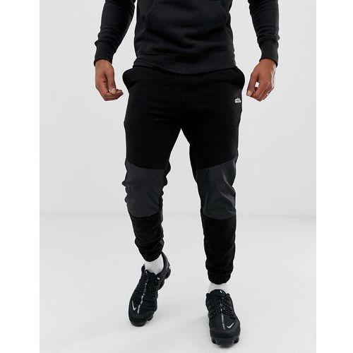 Bershka cuffed jogger in black with panels - Black, kolor czarny