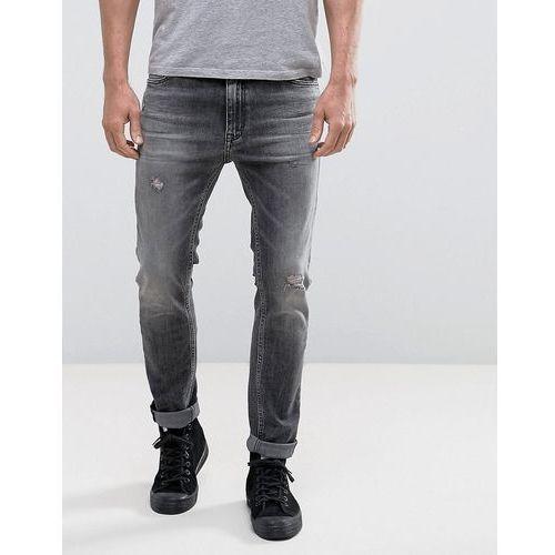 Calvin klein skinny taper fit acid black rip and repair - black marki Calvin klein jeans