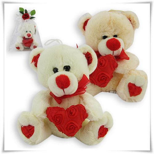 Pluszowy miś z sercem w róże, towar z kategorii: Na pierwszą randkę dla dziewczyny