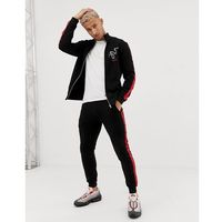 ASOS DESIGN tracksuit track jacket/skinny joggers with snake print and side stripe - Black