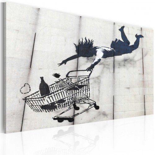 Obraz - upadająca kobieta z wózkiem na zakupy (banksy) marki Artgeist