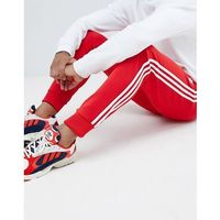 adidas Originals 3-stripe skinny joggers with cuffed hem in red DH5837 - Red, kolor czerwony