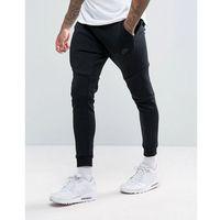 Nike tech fleece slim fit joggers in black - Black, slim