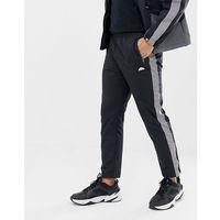 nardo track joggers with relfective side stripe in black - black, Ellesse, M-XL