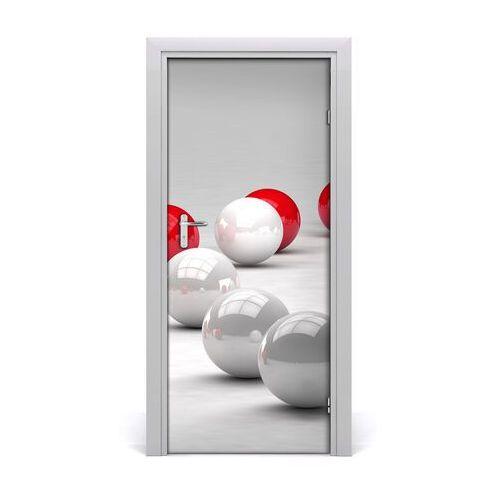 Naklejka samoprzylepna na drzwi czerwono-białe kule marki Tulup.pl