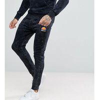 bleached skinny joggers in black - black marki Ellesse
