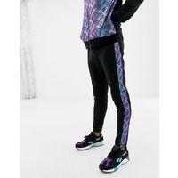 ASOS DESIGN co-ord poly tricot skinny joggers with snake side stripe - Black, kolor czarny
