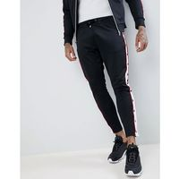 muscle fit skinny joggers in black with poppers - black marki The couture club