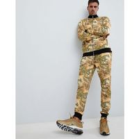 ASOS DESIGN tracksuit track jacket/skinny joggers with tiger print - Yellow, kolor żółty