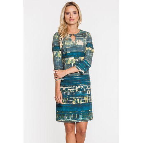 Dopasowana sukienka w niebieskie wzory - marki Potis & verso