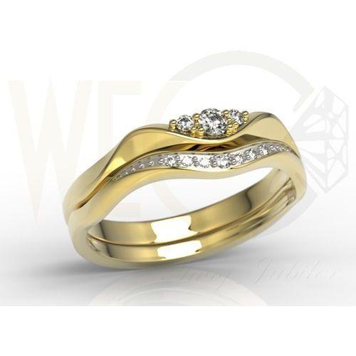 Pierścionek z żółtego złota pr. 0,585 z rodowaniem przy diamentach.