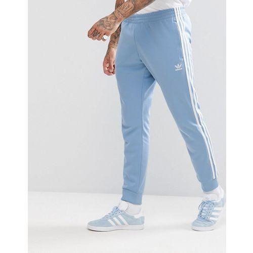 Adidas originals adicolor skinny joggers cuffed hem in blue cw1277 - blue