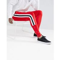 ASOS Skinny Joggers In Red Poly Tricot With Side Stripe And Popper Hem - Red, w 3 rozmiarach