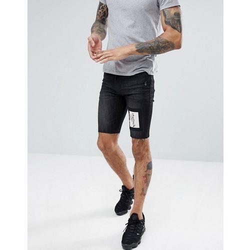 Religion skinny fit denim shorts in black with skeleton patch - black