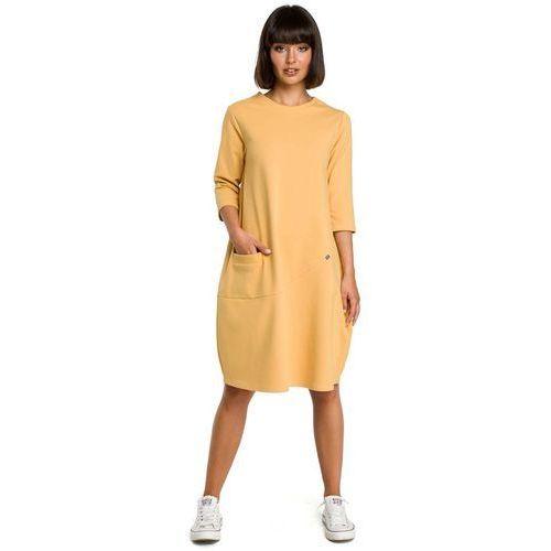 42e798e1a5 Żółta luźna sukienka bombka z ozdobnymi przeszyciami