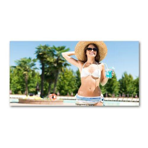 Foto-obraz szklany Kobieta nad basenem