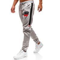 Spodnie męskie dresowe joggery szare denley am033 marki J.style