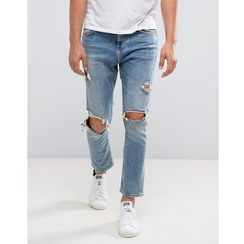 Bershka skinny tapered jeans with rips in mid wash - blue