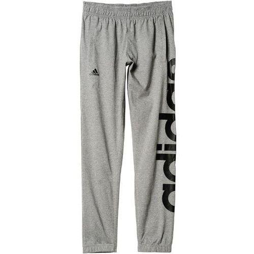 Spodnie linear logo tapered pants ak1570 marki Adidas