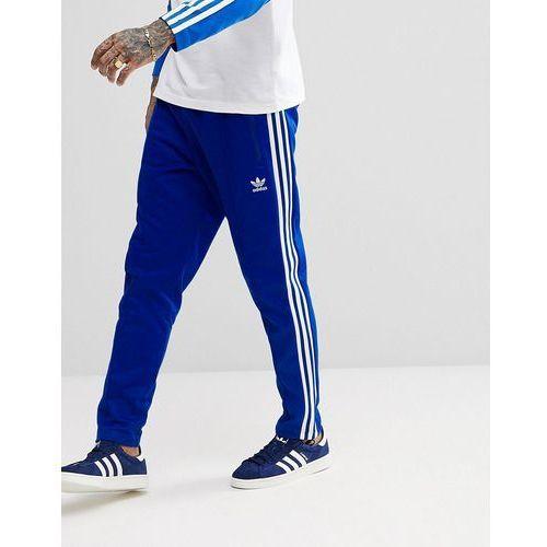 adicolor beckenbauer joggers in skinny fit in blue cw1271 - blue marki Adidas originals